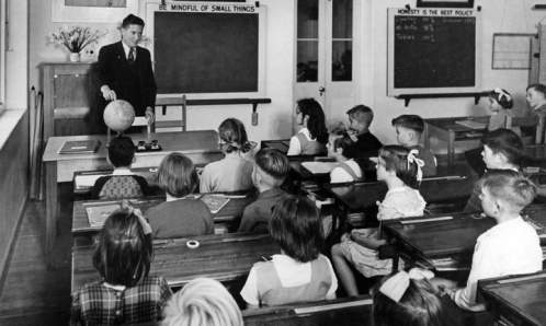queensland_state_archives_1640_kelvin_grove_state_school_teacher_and_class_april_1951